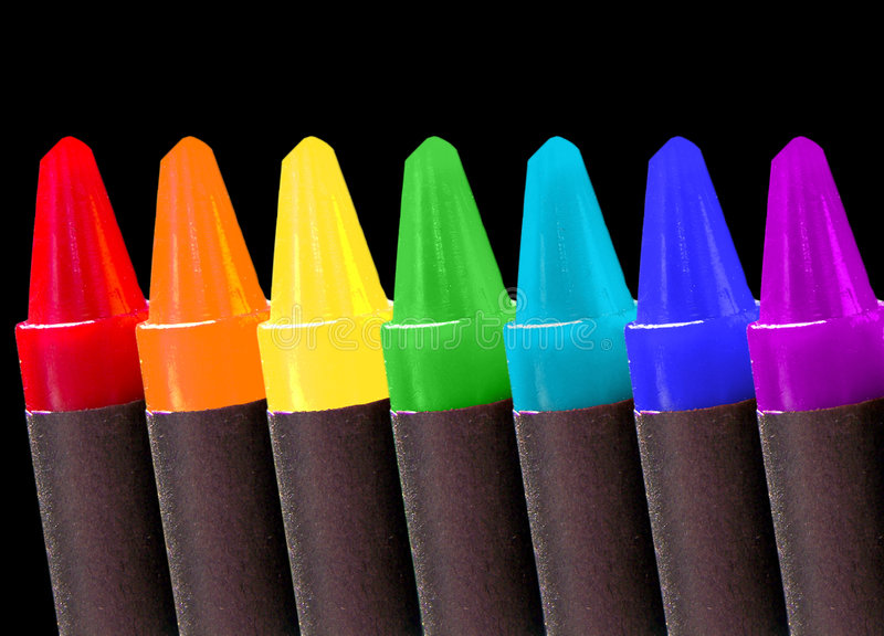 Crayons over black stock photos
