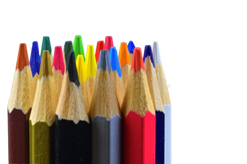 Crayons and pastels lined up. Close up of an assortment colored pencils tips on white background. Background of colorful royalty free stock images