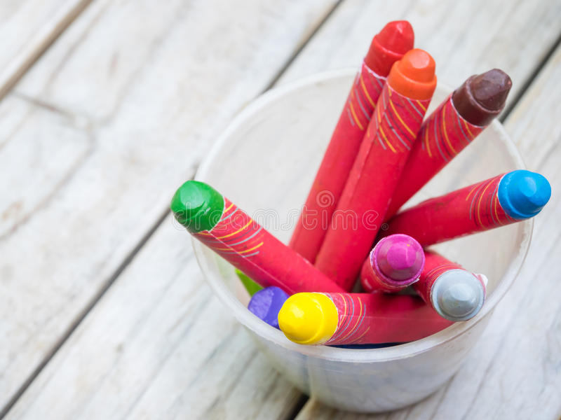 Crayons in plastic glass royalty free stock photo