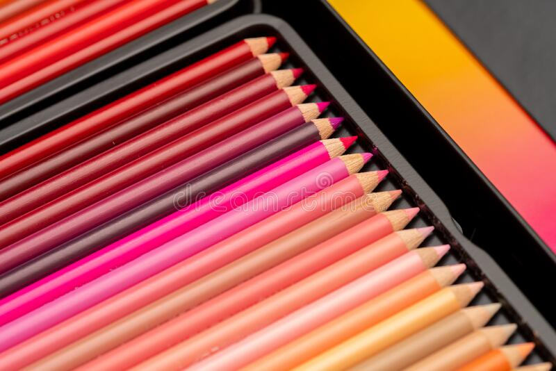 Red coloring pencils in a box stock images