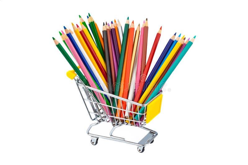 Crayons in shopping cart royalty free stock photos
