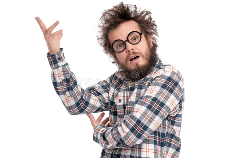Crazy bearded man emotions and signs. Crazy bearded Man with funny Haircut in eye Glasses - ponder and dreaming. Casual thinking guy in plaid shirt, isolated on royalty free stock images