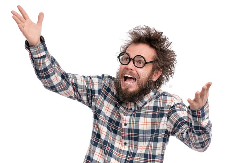 Crazy bearded man emotions and signs. Crazy bearded Man with funny Haircut in Eyeglasses, isolated on white background. Happy guy in plaid shirt is greeting stock photos