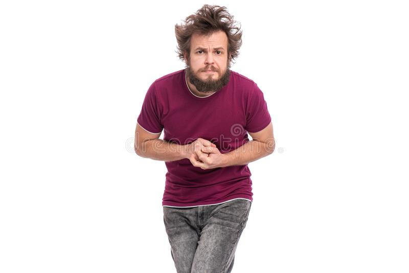 Crazy bearded man emotions and signs. Crazy bearded modest and embarrassed Man with funny Haircut, isolated on white background. He is Shy and looking in camera stock image