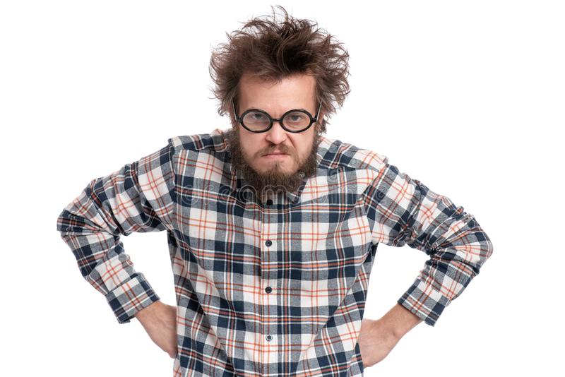 Crazy bearded man emotions and signs. Crazy serious bearded man in eye Glasses with displeased expression, with both hands on hips, isolated on white. Guy in royalty free stock images