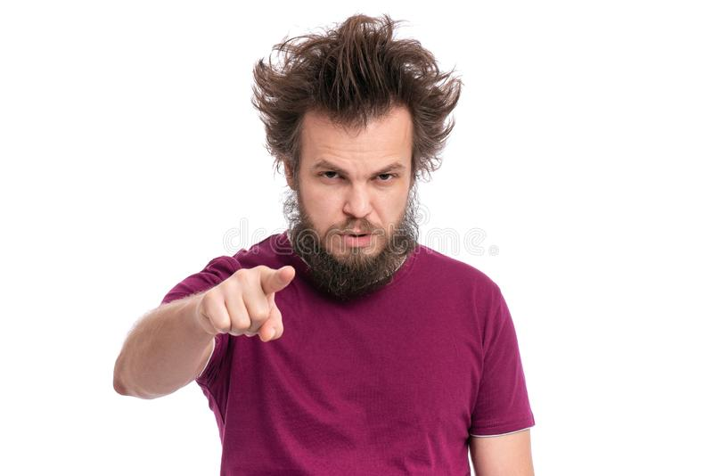 Crazy bearded man emotions and signs. Crazy bearded Man with funny Haircut points his finger at you. Serious Guy looking at camera and pointing to the front stock images