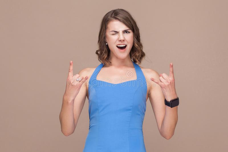 Crazy business woman demonstrate rock and roll sign. stock photo