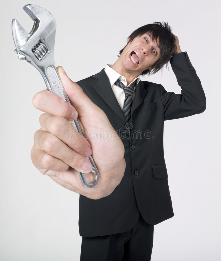 Download Crazy Businessman Holding Wrench Royalty Free Stock Images - Image: 7642049