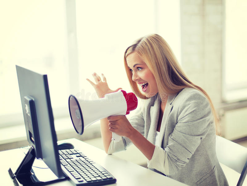Crazy businesswoman shouting in megaphone. Picture of crazy businesswoman shouting in megaphone royalty free stock photo