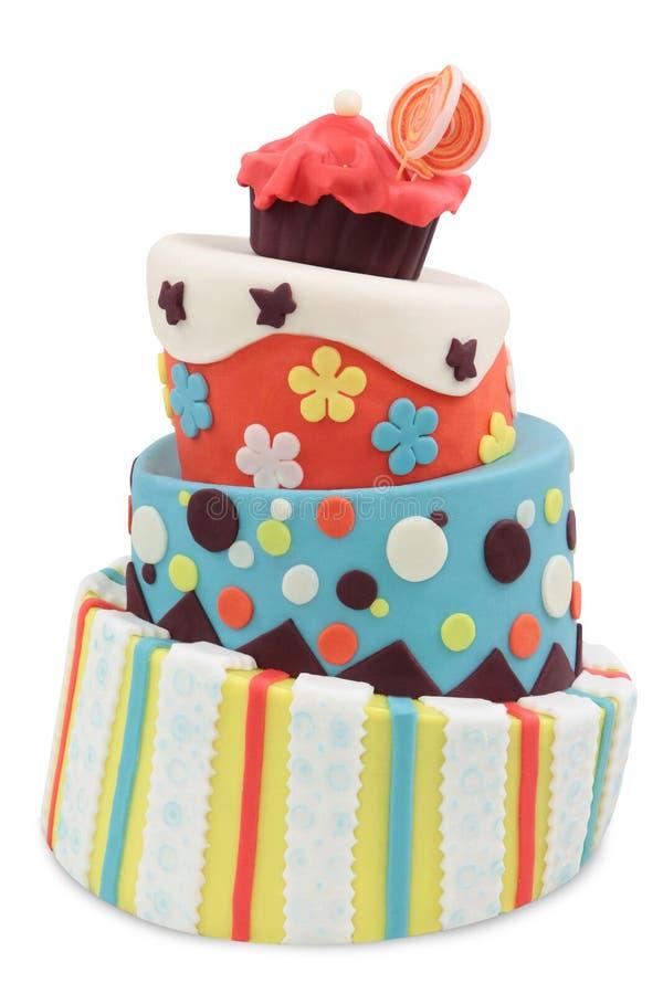 Crazy cake. Decorated with fondant - isolated on white background stock photos