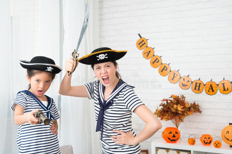 Crazy captain girl and crew mother play game stock image