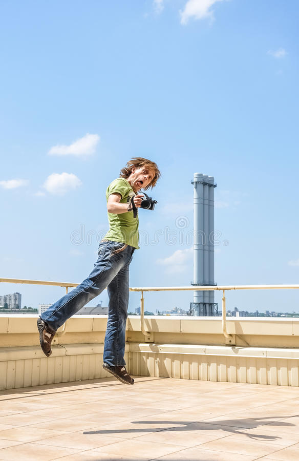 Crazy cheerful photographer royalty free stock images