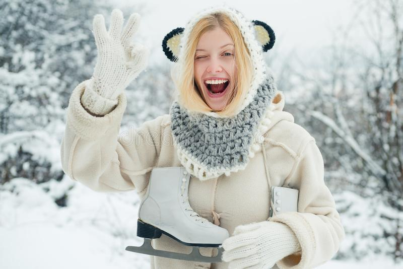 Crazy comical face. Happy winter fun woman. Portrait of a happy teenage girl in the snow. Attractive young woman in stock photography