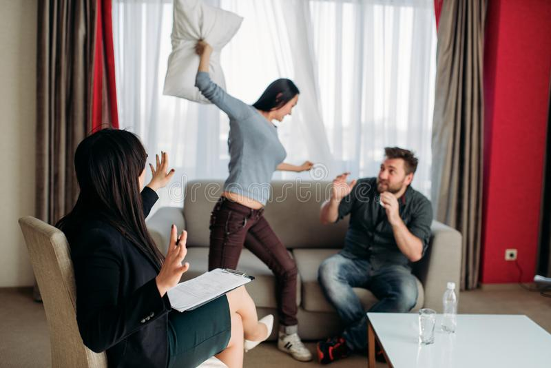 Crazy couple swears at psychotherapist reception royalty free stock photography