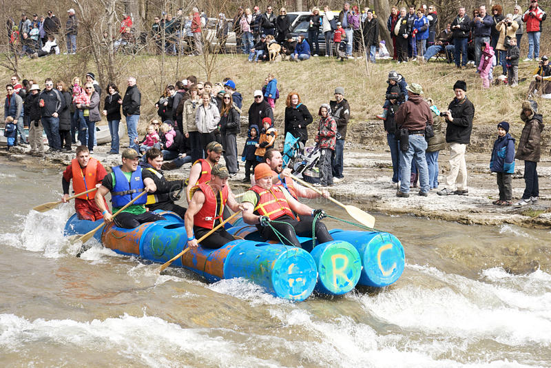 Crazy Craft River Race, Port Hope, March 31/2012. Participants paddle a home made raft through the Ganaraska River rapids on March 31, 2012 in Port Hope, Ontario stock photo