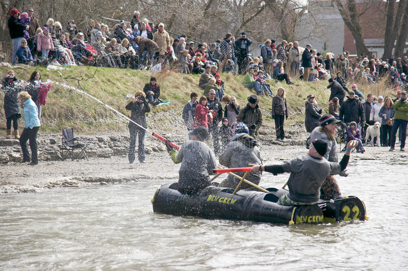 Crazy Craft River Race, Port Hope, March 31/2012. Participants paddle a home made raft through the Ganaraska River rapids on March 31, 2012 in Port Hope, Ontario stock photos