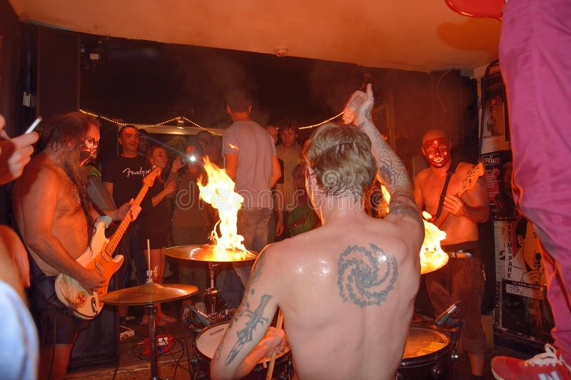 Crazy drummer setting his drum on fire. GHENT, BELGIUM, 19 SEPTEMBER 2014: concert:Daikaiju , KInky Surf at the KinkyStar (bar), Crazy drummer setting his drum royalty free stock images