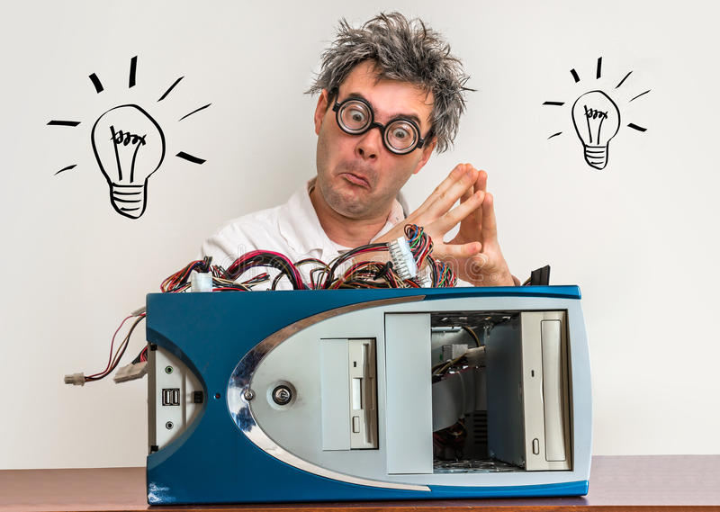 Crazy engineer or scientist repairing computer with bulb symbol royalty free stock photos