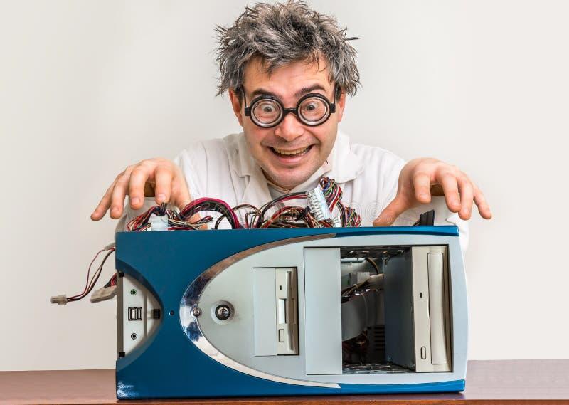 Crazy engineer or scientist repairing computer royalty free stock image