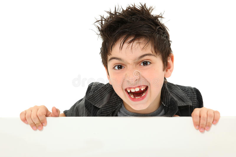 Crazy Excited Boy Holding Blank Canvas. Adorable and funny 8 year old boy making silly animal face while holding blank canvas over white stock images
