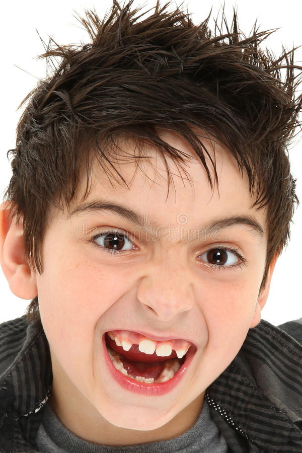 Crazy Face Close Up Child. Hilarious 8 year old boy making crazy face up close royalty free stock images