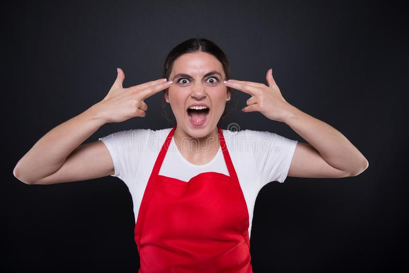 Crazy female employee blowing up her mind. And having fun on dark background stock photos