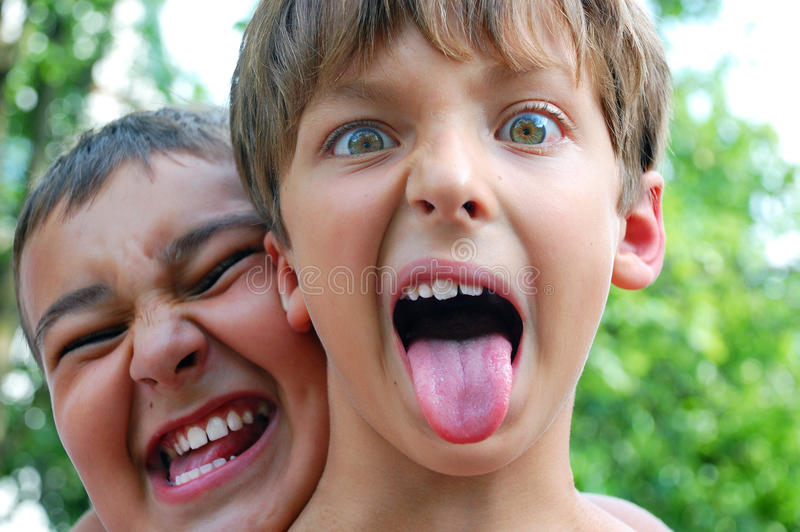Crazy funny children faces royalty free stock images