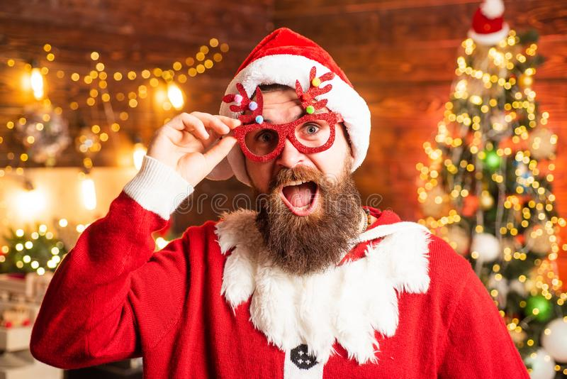 Crazy, funny Hipster Santa. Hipster man, bearded Santa celebrate Thanksgiving day and Christmas. stock image