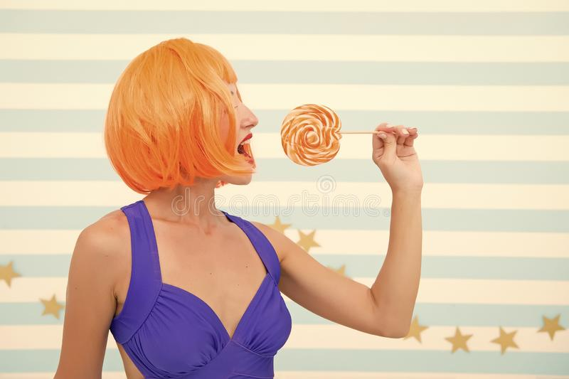 Crazy girl in playful mood. Cool girl with lollipop. Sexy woman. happy pinup model with lollipop in hand. Fashion girl royalty free stock photos