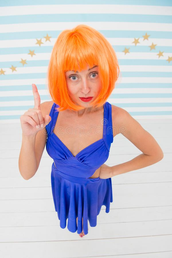 Crazy girl point finger up with strictness. Strict girl show strictness with crazy look. follow my order. Follow my royalty free stock image