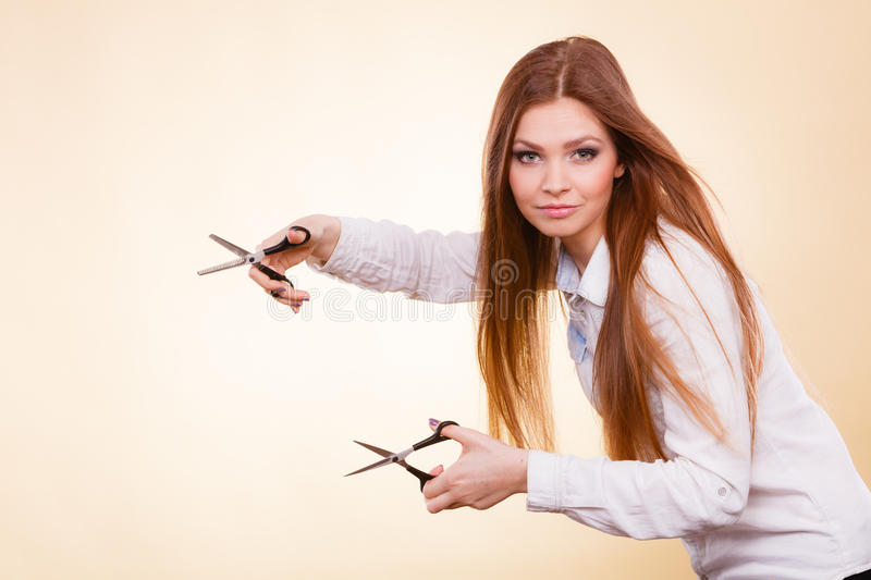 Crazy girl with scissors. Hairdresser in action. Craziness of professional hairdresser. Hair hygiene. Girl with scissors making crazy funny face preparing royalty free stock image
