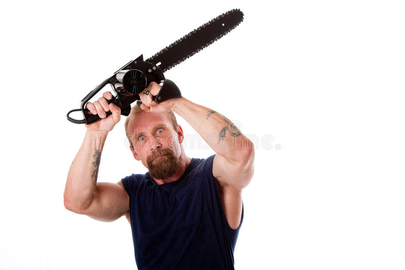 Crazy guy with chainsaw stock image