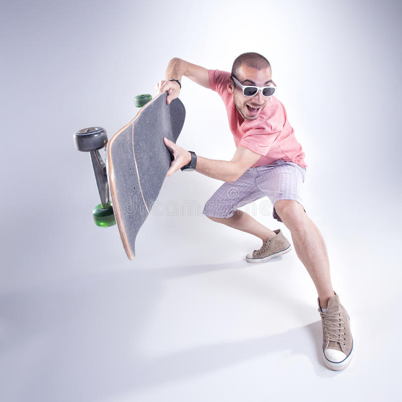 crazy guy with a skateboard making funny faces stock photo