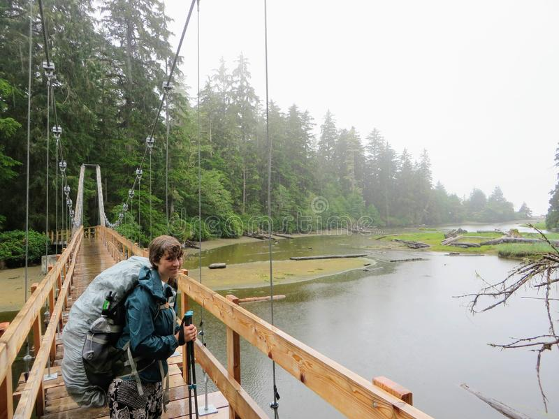 Crazy hike along the beautiful misty coasts and forest of Vancouver Island doing the rugged West Coast Trail. Many bridges and l. Adders and other fun obstacles royalty free stock image