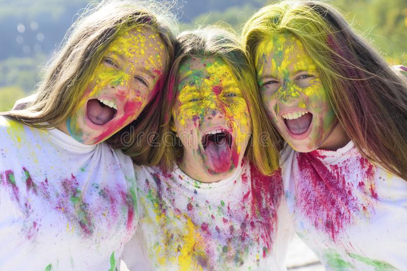 Crazy hipster girls. Happy youth party. Optimist. Spring vibes. positive and cheerful. colorful neon paint makeup. Children with body art. Girls with colorful stock photos