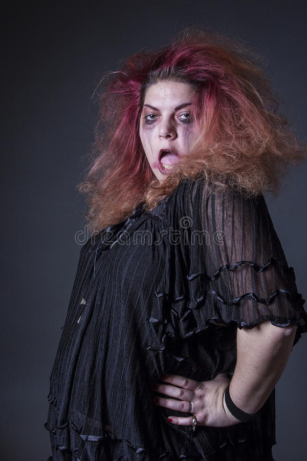 Crazy horror woman posing. Deranged, mad woman posing casually stock photography
