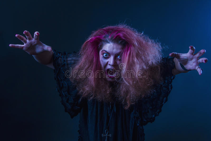 Crazy horror woman screaming. Mad, deranged girl about to attack, screams loudly royalty free stock photo