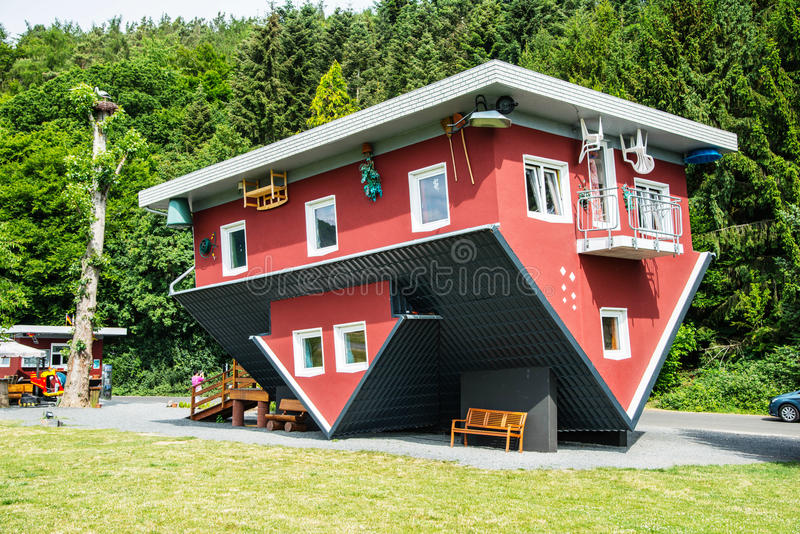 Crazy house on Edersee, Germany. The crazy house on Edersee in Affoldern, Germany. The red house is standing head over. it is an attraction in Germany. The royalty free stock photo