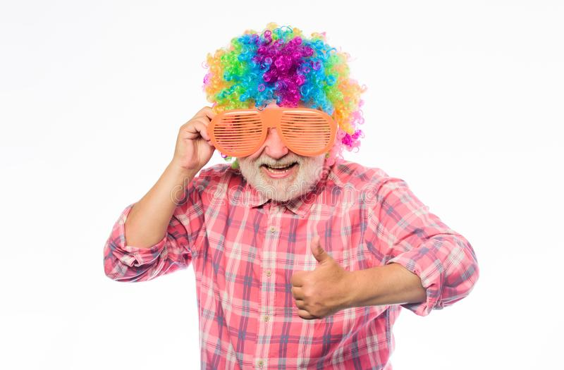 Crazy idea. happy birthday. corporate party. anniversary holiday. happy man with beard. Celebration retirement. mature. Bearded man in colorful wig and party stock photography