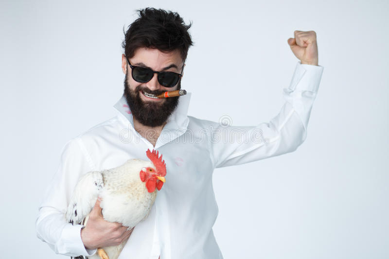 Crazy insane man in with chicken and cigar stock images