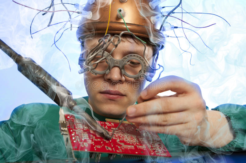 Crazy inventor replacement of electronic components stock photo