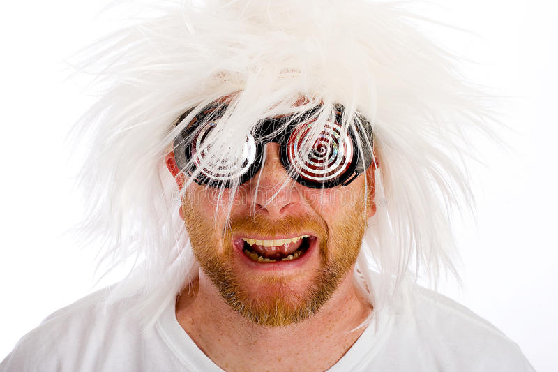 Crazy Man. A crazy looking man with with a wild looking white wig and swirled glasses stock images