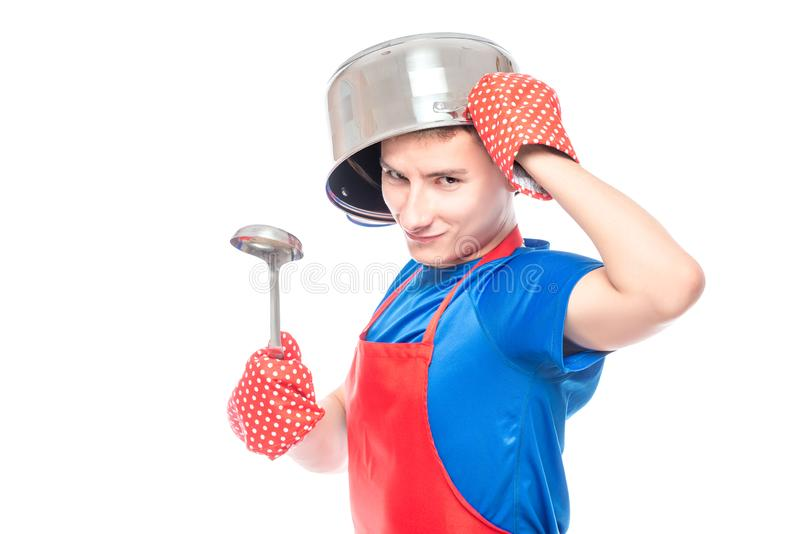crazy man in an apron with a pan on his head posing on a white stock photography