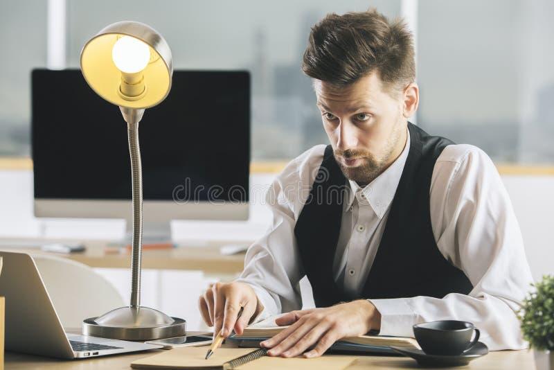 Crazy man interrogating someone stock photography