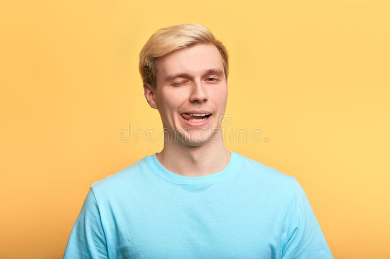 Crazy man making faces while looking at the camera stock photo