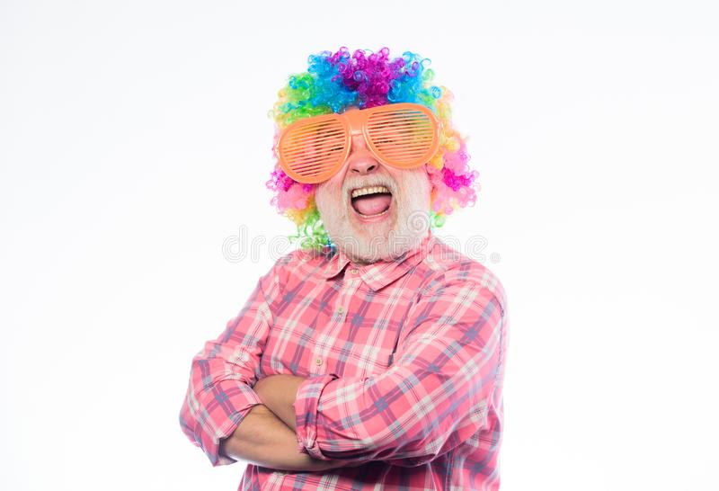 Crazy man in playful mood. anniversary holiday. happy birthday. corporate party. happy man with beard. Celebration. Retirement. mature man in colorful wig and stock image
