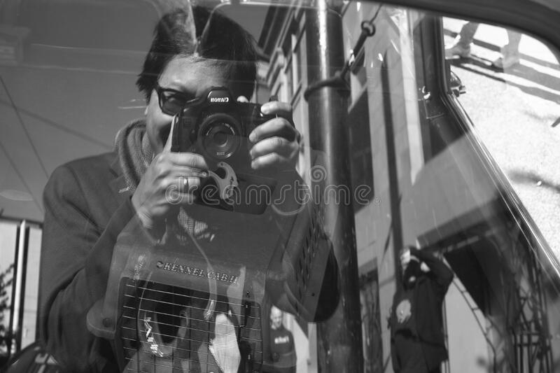 crazy man uses 11 year old camera 11October2016 stock image