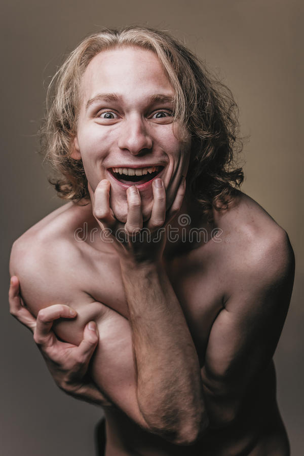 Crazy nude blonde man scary laughter stock photos