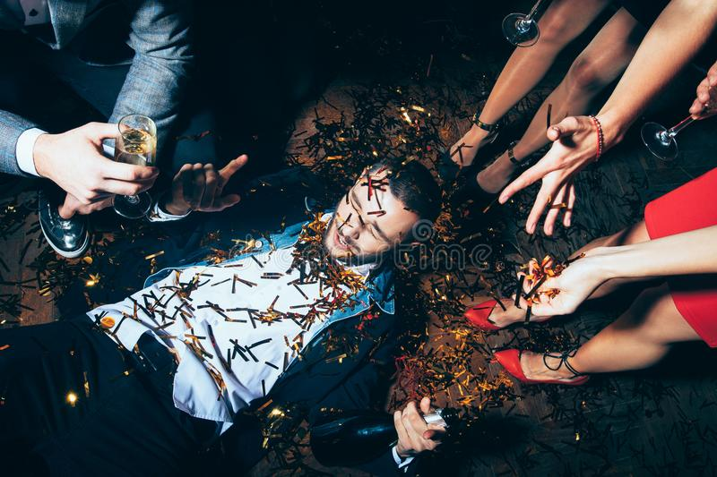 Crazy party. Drunk man lying on floor. Crazy party. Drunk men lying on floor. New year, Birthday, Holiday Event concept royalty free stock photo