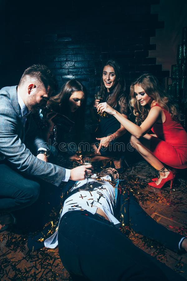 Crazy party. Drunk man lying on floor. Crazy party. Drunk men lying on floor. New year, Birthday, Holiday Event concept stock photo
